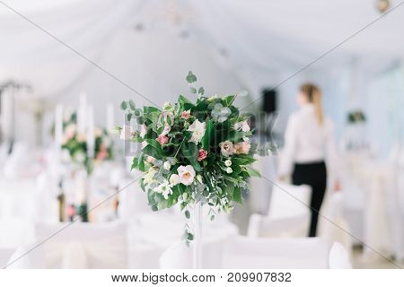 Beautiful Wedding Floral Decoration On A Table In A Restaurant. White Tablecloths, Bright Room, Cand