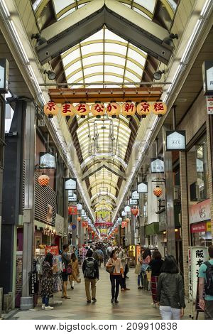 Kyoto, Japan - May 17, 2017: Pedestrians walking in the Shin Kyogoku Shopping Arcade in Kyoto