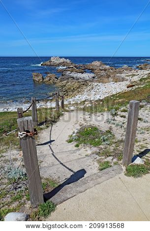 Stairs and walkway to the rocky beach at Asilomar State Beach on the Monterey Peninsula in Pacific Grove California vertical