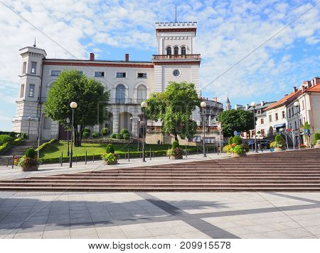 BELSKO-BIALA in POLAND EUROPE on AUGUST 2017: Sulkowski Castle in historical city center with empty square in downtown and clear blue sky in warm sunny summer morning day.
