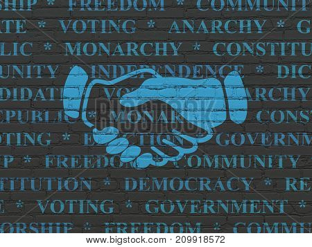Political concept: Painted blue Handshake icon on Black Brick wall background with  Tag Cloud