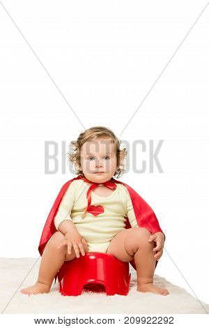 Toddler In Superhero Cape With Pottie