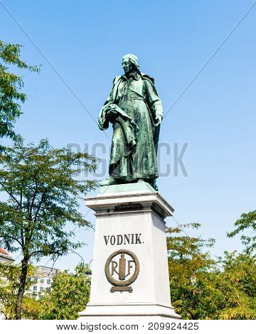 Vodnik monument is named after Valentin Vodnik, a Slovene priest, journalist, and poet from the late Enlightenment period. There is a monument with a statue in the square commemorating him.
