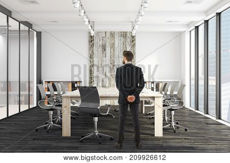 Handsome european businessman standing in modern meeting room with equipment and sunlight. Employee worker excecutive concept. 3D Rendeirng