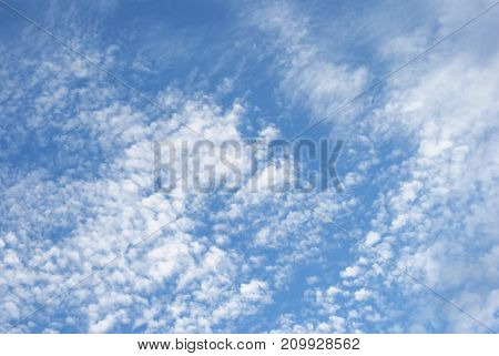 Bright Blue Sky With White Fluffy Clouds On Fine Day