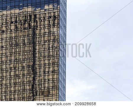 Building Reflected On Glass Windows