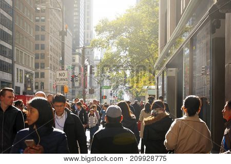 New York, USA, november 1, 2016: crowd of people walking along the famous fifth avenue in Manhattan New York