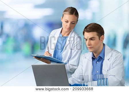 Two research scientists computer equipment female young