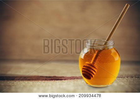 Honey dipper honey dipper health food made of wood yellow background