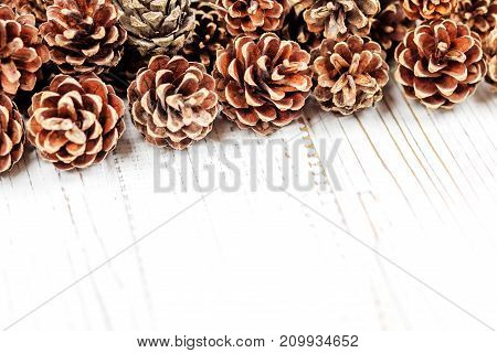 Cones on a white wooden background. Concept Happy Christmas New Year holiday winter.
