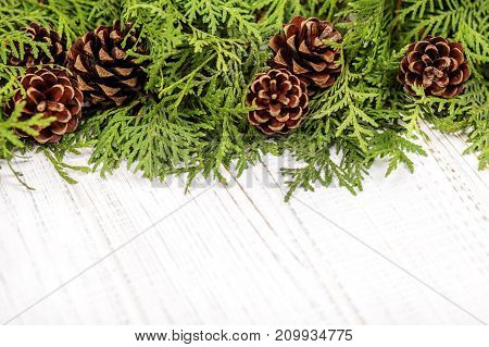 Christmas tree and cones on a wooden background. Concept Happy Christmas New Year holiday winter.