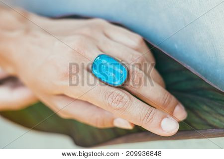 Master jeweler produces a ring with a big blue stone