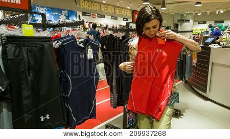 Eskisehir, Turkey - August 11, 2017: Young Woman Looking At A Sports Clothing In A Sports Shop In Es