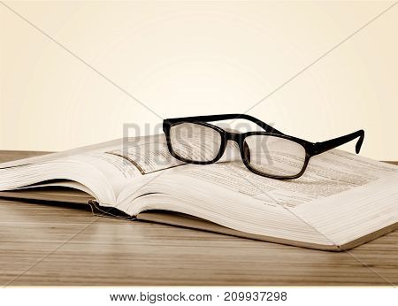 Black reading glasses reading glasses close up book shelves table
