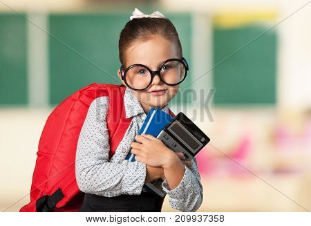 Girl school calculator business success caucasian child
