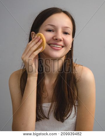 young girl applying a white hand cream