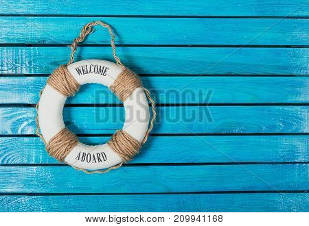 Blue background wooden lifebuoy design travel vacations