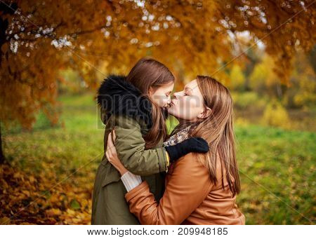 Happy Family Mother And Child Little Daughter Playing On Autumn Walk. Happy Family. The School Holid