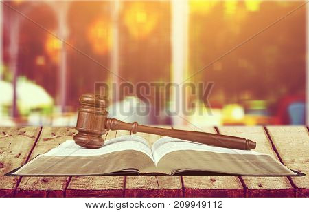 Wooden book gavel table background paper closeup