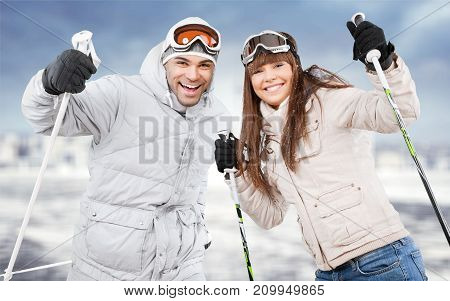 Happy young couple skiers looking at camera winter sport sport