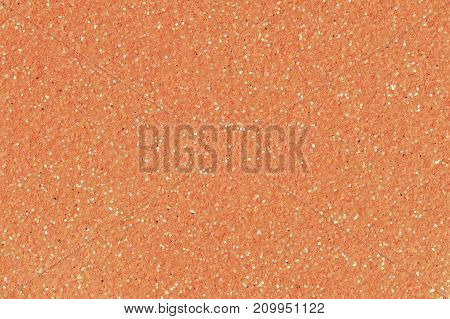 Orange glitter texture christmas background. Low contrast photo.