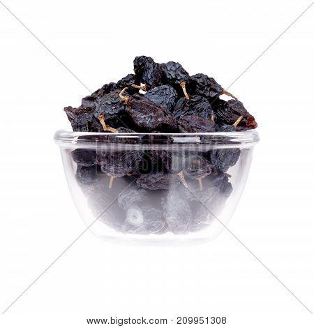 Saucer of prunes, closeup. High resolution photo. High resolution photo