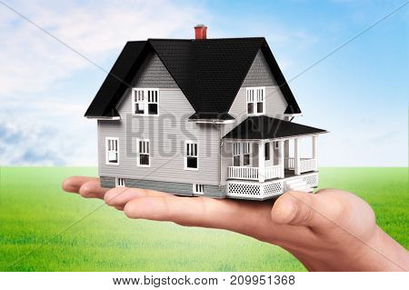 Holding model hand house closeup business human