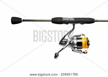 Spinning rod close up isolated on white background. High resolution photo.