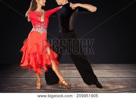 Man woman dancing salsa fun red entertainment