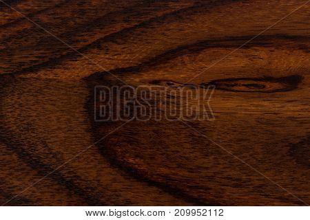 Dark wood texture closeup background. Hi res photo.