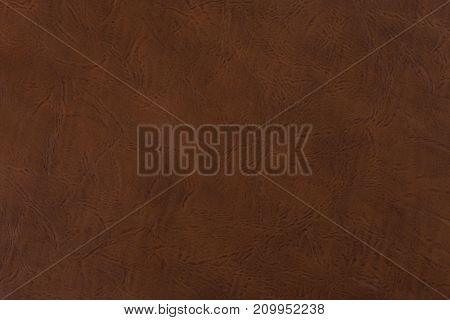 Brown leather background or texture. High resolution photo.