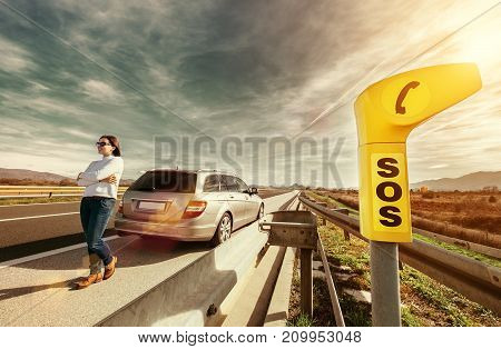 SOS service point on highway - woman driver has a problem with car