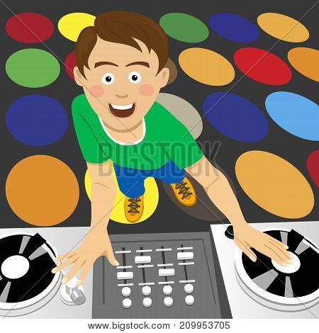 Young disk jockey for the vinyl disks and mixer in the club