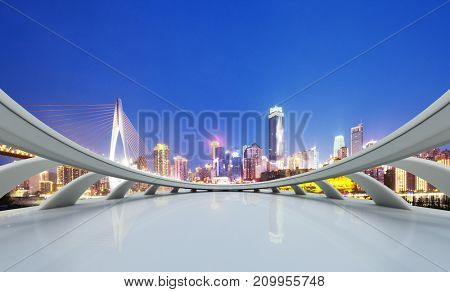 empty marble floor and modern suspension and cityscape of chongqing at night