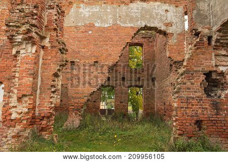 The ruins of an ancient building of red brick. The building is in a dilapidated condition. Abandoned collection. City Disna Belarus. View from the inside.