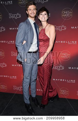 LOS ANGELES - OCT 04:  Jack Quaid and Elizabeth McGroder arrives for the People's 'One's To Watch' Event on October 4, 2017 in Hollywood, CA
