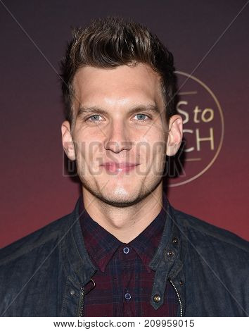 LOS ANGELES - OCT 04:  Scott Michael Foster arrives for the People's 'One's To Watch' Event on October 4, 2017 in Hollywood, CA