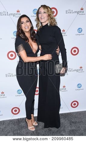 LOS ANGELES - OCT 12:  Eva Longoria and Felicity Huffman arrives for the Eva Longoria Foundation Dinner on October 12, 2017 in Beverly Hills, CA