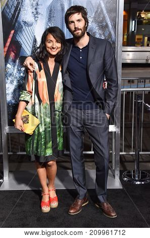 LOS ANGELES - OCT 16:  Jim Sturgess and Dina Mousawi arrives for the