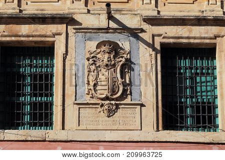 MURCIA, SPAIN - MAY 19, 2017: It is the coat of arms of the bishop of Cartagena and the Spanish politician of the XVIII century Obispo Rojas-y-Contreras on the building.