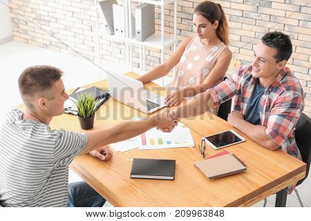 Human resources manager shaking hands with applicant