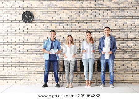 Group of people waiting for job interview in hall