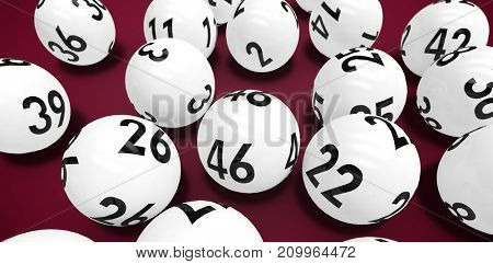 Close-up on lottery balls against pink background