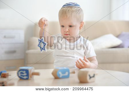 Little Jewish boy with Star of David at home