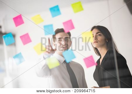 Startup Business People Two Working Everyday Job At Modern Office With Stickers. Man Pointed On Stic