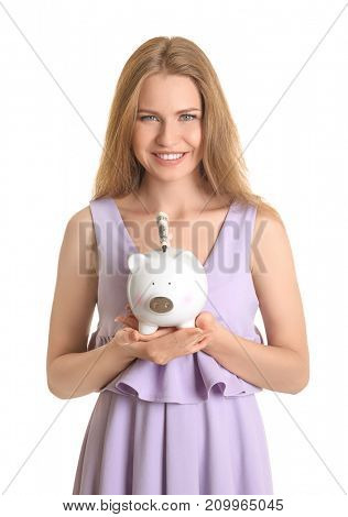 Young woman with piggy bank on white background