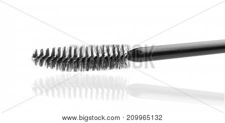 Mascara wand on white background