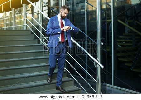 Handsome busy businessman outdoors