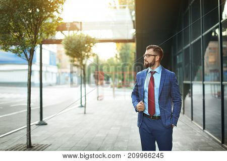 Handsome successful businessman outdoors
