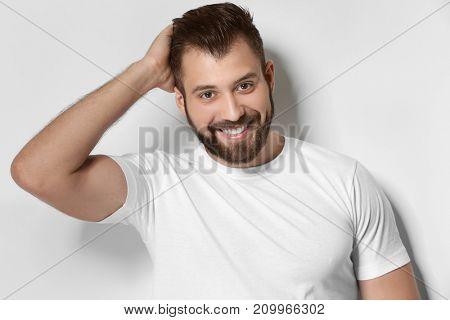 Handsome man on light background